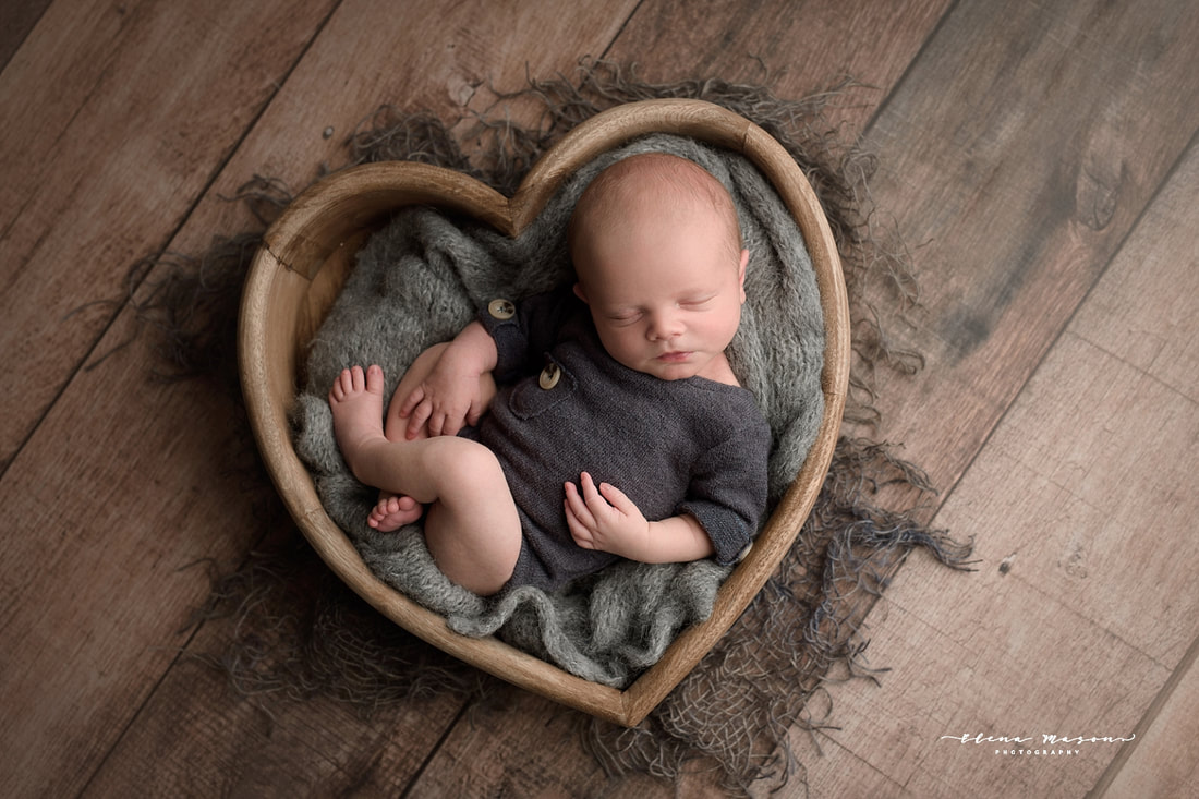 sleeping baby in heart bowl, newborn photo session, newborn photography Belfast