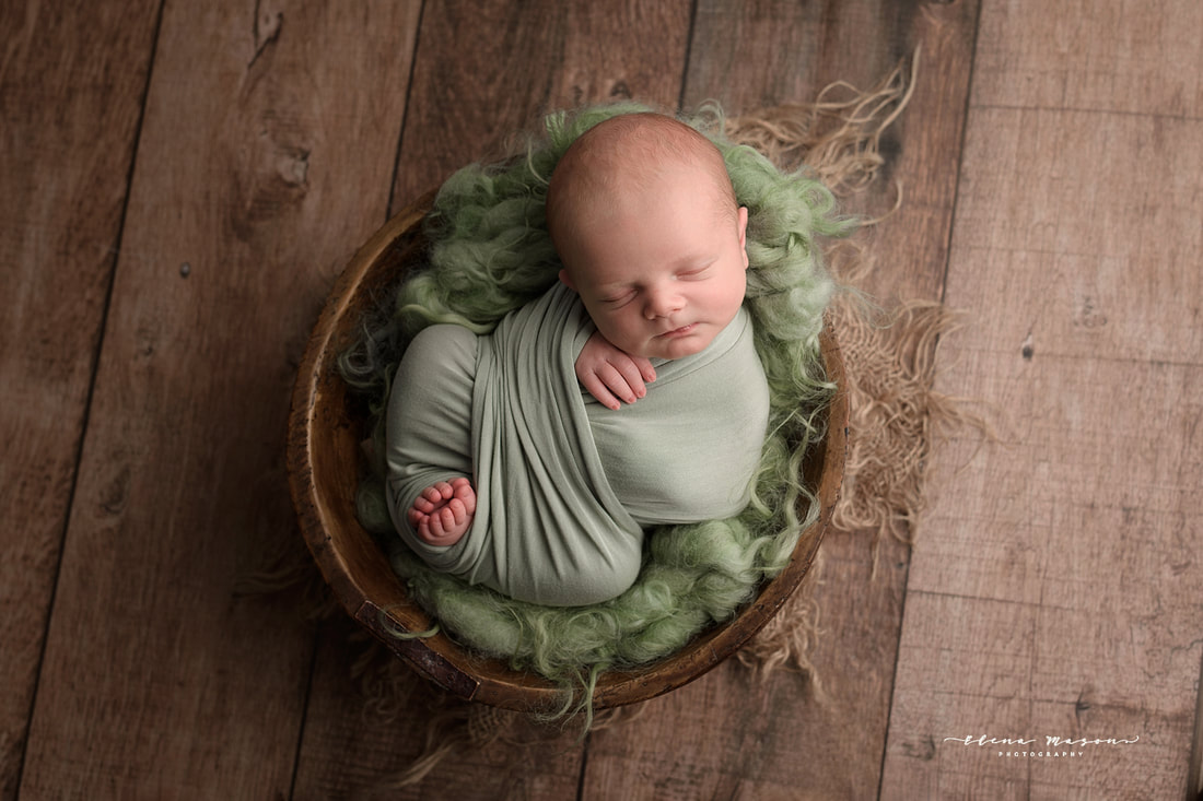 sleeping baby in bowl on green, newborn photo session, newborn photography Belfast