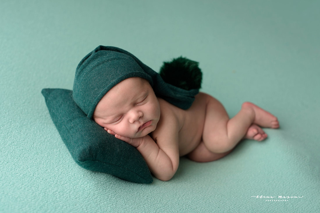 sleeping baby on green, newborn photo session, newborn photography Belfast