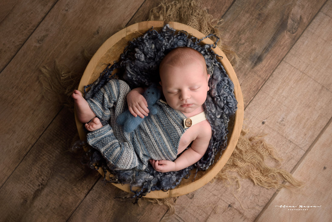 newborn baby in blue in bowl, newborn photo session Belfast